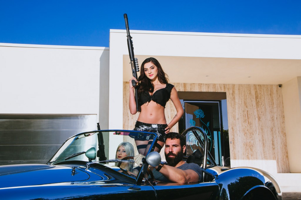 LOS ANGELES, CALIFORNIA - MARCH 13: Dan Bilzerian, gambler, high roller, movie producer and actor, poses in his reflective 1965 427 Shelby Cobra at his lavish Los Angeles home in the hills high above West Hollywood on Thursday, March 13, 2014 in Los Angeles, California. Bilzerian was recently named 'Instagram's Playboy King' due to his frequent postings of himself with scantily clad women, guns, cars, and stacks of cash. (Credit: David Walter Banks)